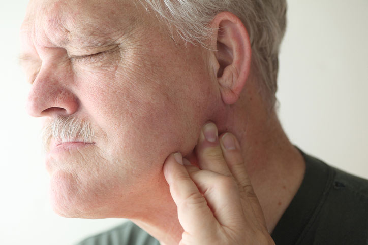 Man suffering from pain due to an oral injury